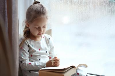 Religious Christian girl praying over Bible