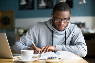 man focusing on his studies
